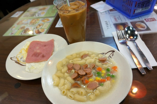 A typical Hong Kong-style breakfast: macaroni soup with ham and eggs, paired with a glass of ice milk tea